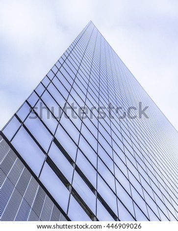 high office geometric buildings on blue sky background