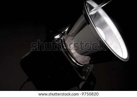 High output studio strobe flash isolated on black