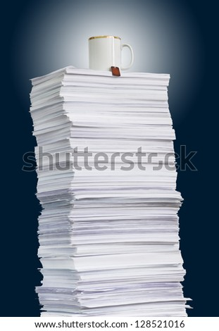 high paper stack and a cup of tea - stock photo