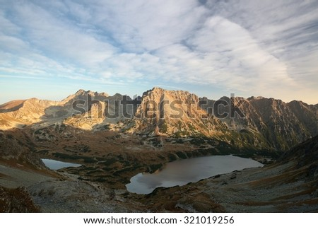 High peaks of the Tatra mountains at dawn. - stock photo