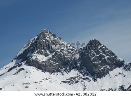 High peaks 'Pizzo del Diavolo di Tenda' and 'Diavolino' ('peak of the devil' and mount 'little devil') in the Bergamo Alps, Lombardy, Italy - stock photo