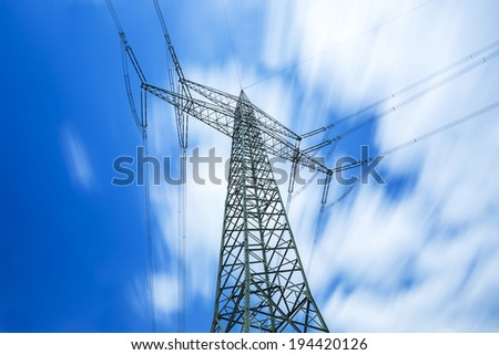 high pipeline pylon with dynamic blue cloudy sky