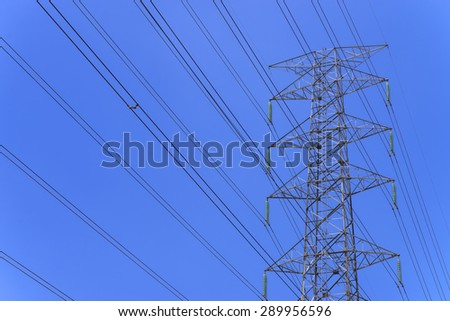 High power electricity pole with clear blue sky
