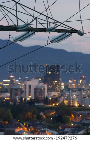 High power electricity poles in urban area - stock photo