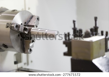 High precision CNC lathe machining turing automotive parts - stock photo