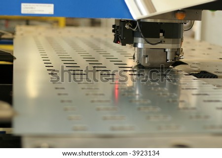 High precision CNC sheet metal stamping and punching machinery. - stock photo