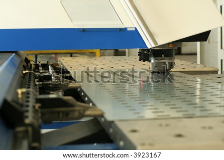 High precision CNC sheet metal stamping and punching machinery. - stock photo