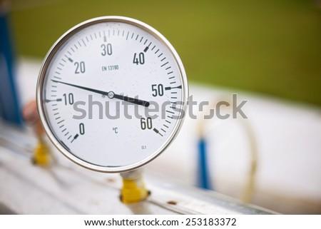 High pressure reading on gas wellhead  - stock photo