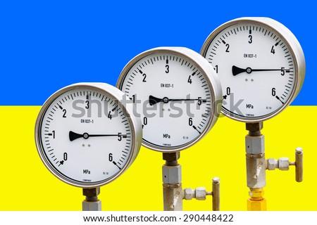 High pressure reading on gas wellhead isolated on flag Ukraine  - stock photo