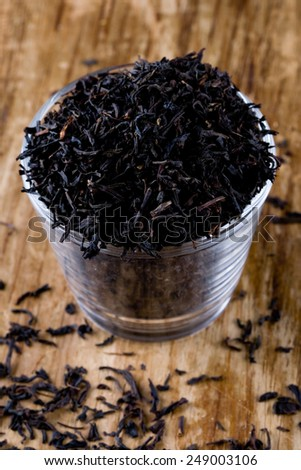 high quality black tea in glass closeup on wooden background - stock photo