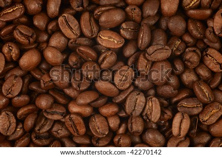 High quality fresh roasted coffee beans. Close-up. Background. - stock photo