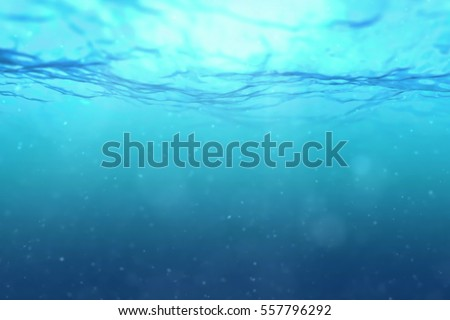 high quality perfectly seamless loop of deep blue ocean waves from underwater background with micro particles flowing, light rays shining through