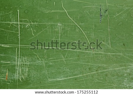 High quality textured and abstract weathered natural scratched dark green paint pattern with aged and grunge look which can be used as a wallpaper or background - stock photo
