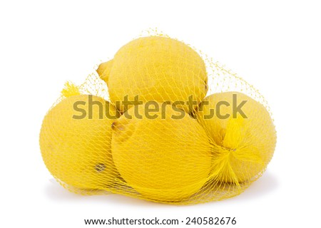 High resolution and quality photo of ripe lemons in a net bag on a white background.  - stock photo