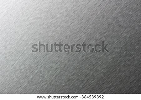 High resolution brushed metal or textured metal, with deep grooves. Intentionally highlighted on upper left hand corner. Diagonal texture. Sharp to the corners. - stock photo