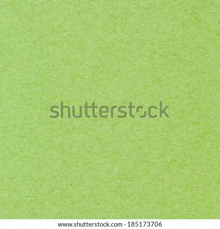 High resolution green recycled paper texture as background - stock photo