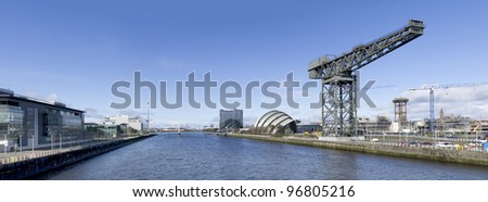 High resolution panorama of the River Clyde in Glasgow showing Finnieston Crane, Armadillo, Bell's Bridge and Science Tower. - stock photo