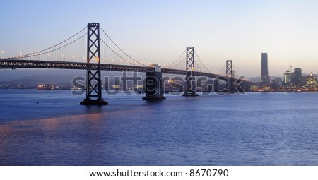 High-resolution panoramic image of Bay Bridge  at dusk (shot from Treasure Island).   Copyspace on top and bottom. - stock photo
