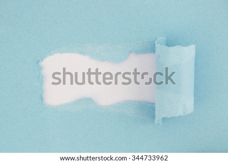 High resolution photography of torn blue paper - visible paper texture - stock photo