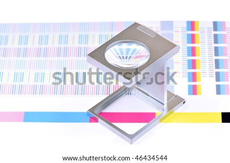 High resolution white background macro studio image of a linen tester and CMYK color sample. - stock photo