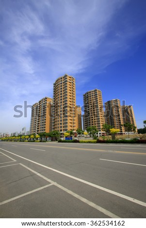 High-rise building under the blue sky, city scenery - stock photo
