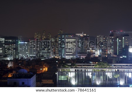 high rise buildings at night - stock photo