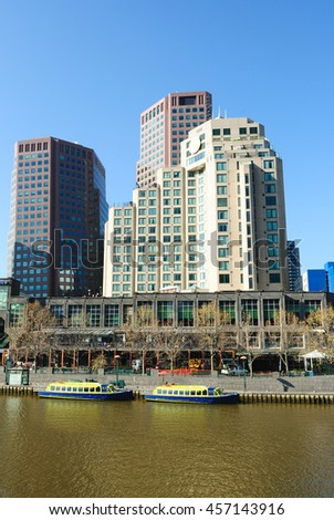 High-rise buildings in downtown Melbourne with the Yarra River in the foreground - stock photo
