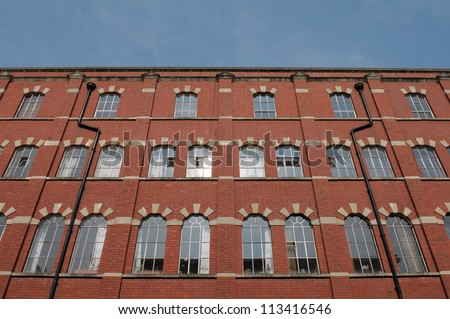 High Rise Red Brick Apartment Block - stock photo