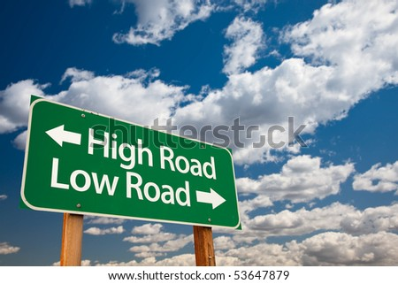 High Road, Low Road Green Road Sign with Copy Room Over The Dramatic Clouds and Sky. - stock photo