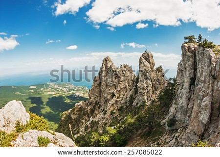 High rocks Ai-Petri of Crimean mountains. Black sea coast and blue sky with clouds. Russia. Photographed fisheye lens - stock photo