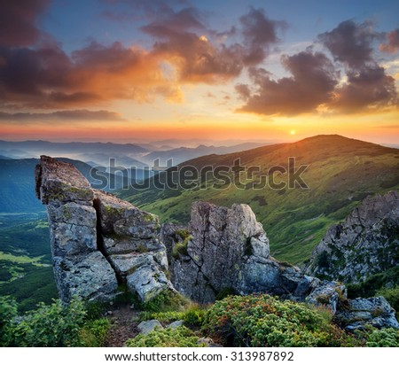 High rocks in mountain valley during sunrise. Natural summer landscape