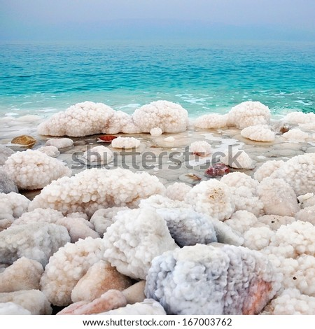 High saturation Dead sea view with salted rocks - stock photo