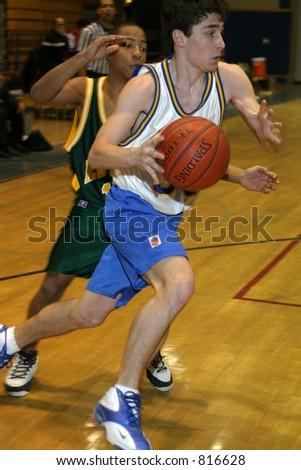 High school basketball. Editorial use only - stock photo
