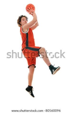 High-school basketball player gets a shot - stock photo