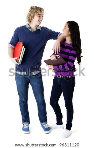 high school couple holding books and looking at each other