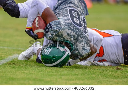 High school football player in for the touchdown. - stock photo