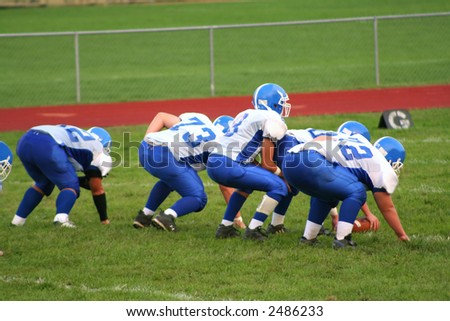 High school football players during a game. - stock photo