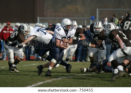 High school football players. Editorial use only. - stock photo