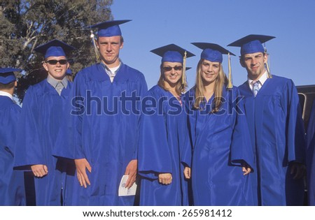 High school graduates pose after their commencement ceremony, Nordhoff High School, Ojai, CA - stock photo