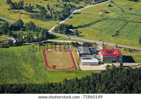 High school near village from above - stock photo
