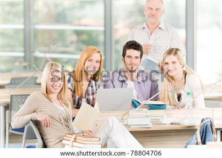 High-school or university young study group with mature professor - stock photo