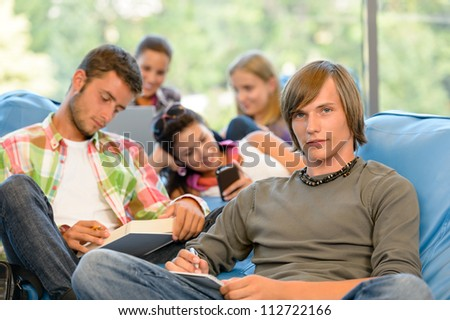 High-school students in study room reading writing young - stock photo