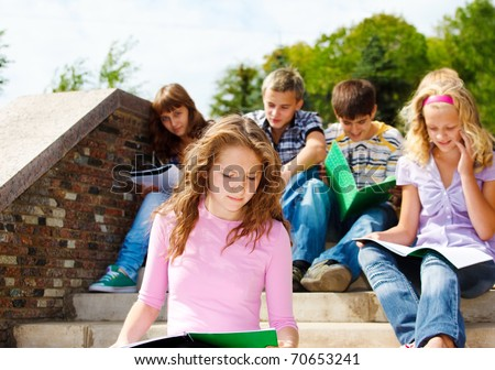 High school students studying in the outdoor - stock photo