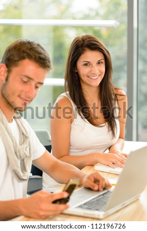 High-school students working on laptops in study academic library campus - stock photo