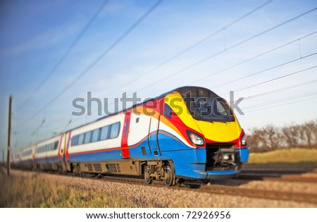 High speed diesel train passing in a blur - stock photo
