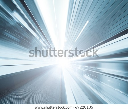 high-speed moving escalator - stock photo