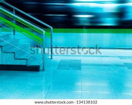 high speed moving train and stairs in subway station.