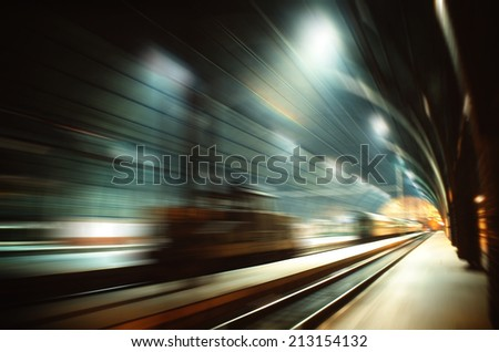 High speed railway travelling - motion blurred image of railway terminal hall - stock photo