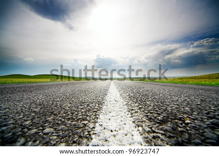 High speed road with cloudy sky background