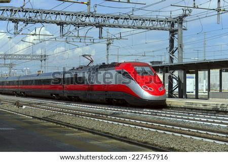 high-speed train at the railway station of the European city - stock photo